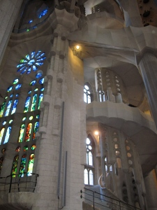 Staircase and glass mosaic window inside La Sagrada Familia